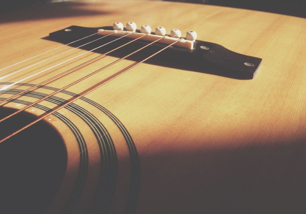 https://www.pexels.com/photo/closeup-photo-of-acoustic-guitar-body-and-string-230800