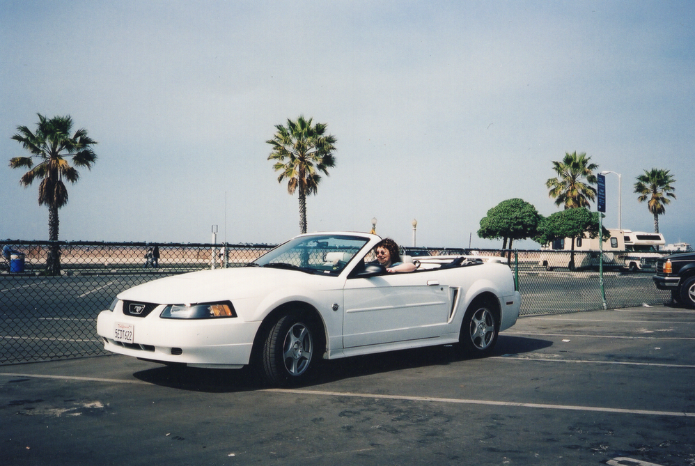 Karen in a white Mustang at Santa Monica Beach