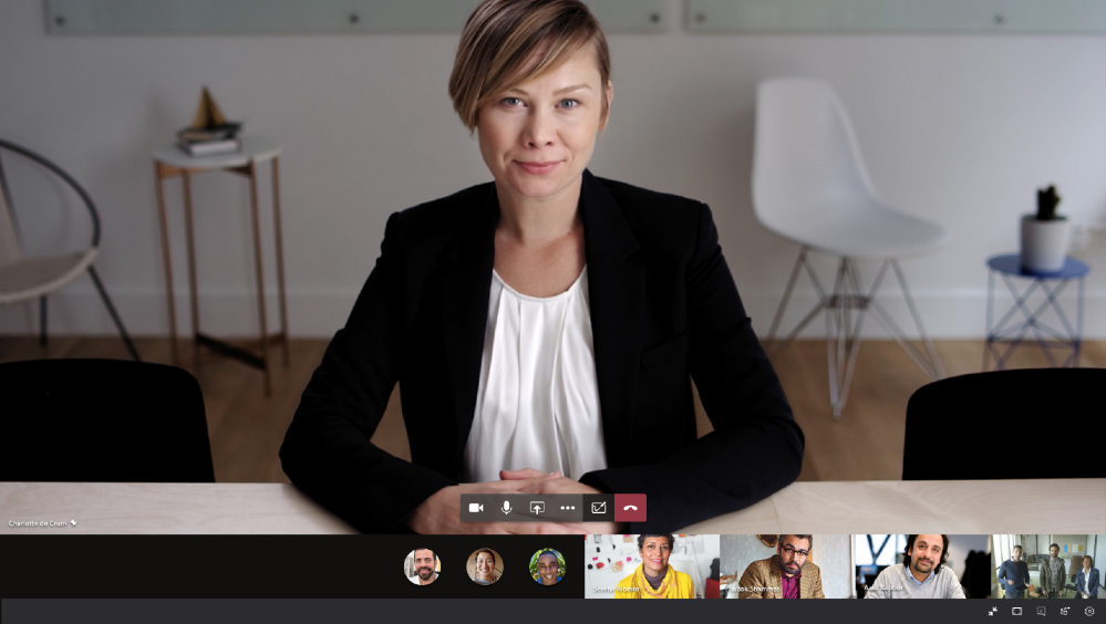 Microsoft Teams video meeting on a Surface Hub featuring a pinned video