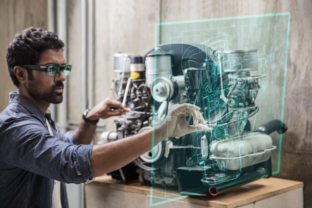 Man using AI glasses with machinery
