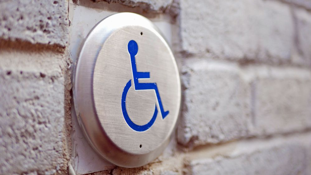 Picture of a disabled access door button