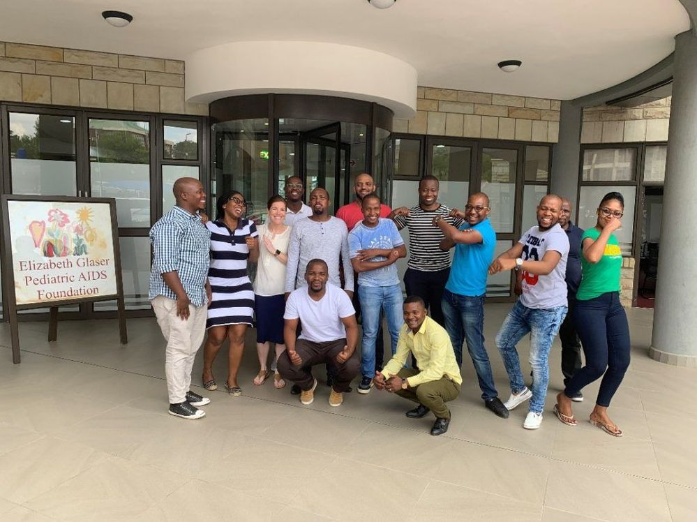 The Lesotho Informatics team relaxes during a break from Power BI training.