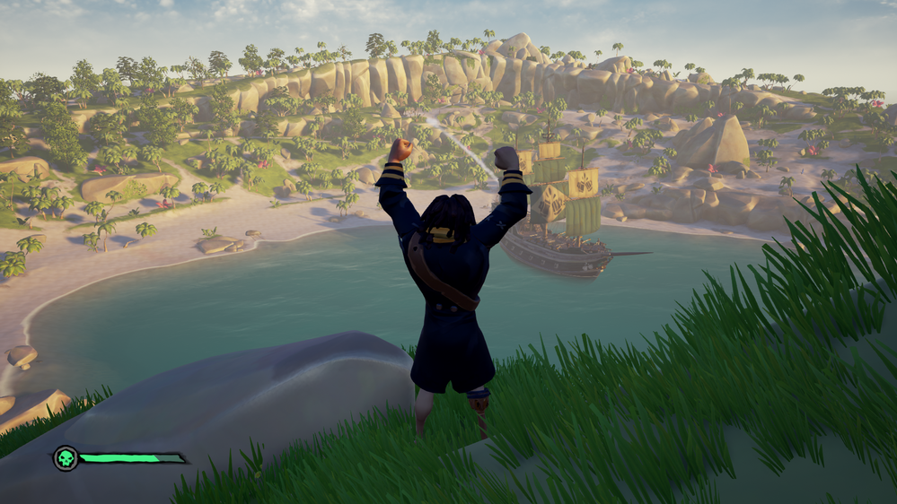 Looking down over the pirate town and your ship from atop a hill