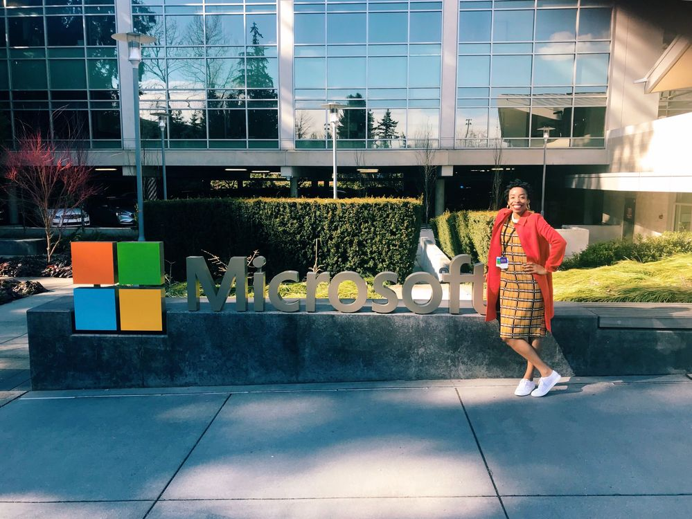April is standing in front of the Microsoft sign on her first day at Microsoft.