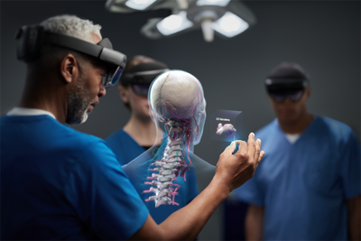 Healthcare professionals using HoloLens to interact with a holographic render of an anatomical model