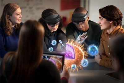A group of students analyze a 3D render using HoloLens.