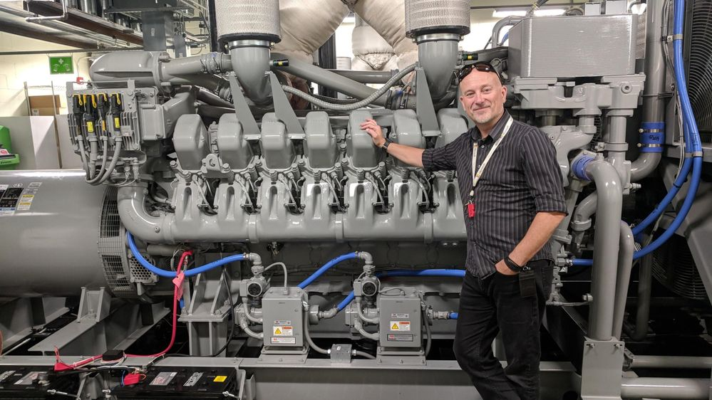 Richard Harrison, datacenter technical architect, standing in front of one of the diesel backup generators onsite at the Microsoft datacenter lab.