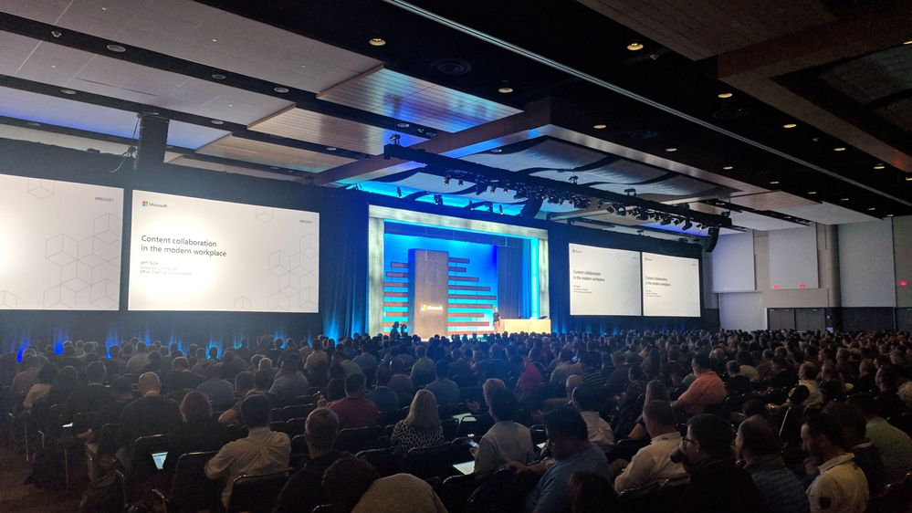 Panorama of audience and Jeff Teper as he kicks off the SharePoint, OneDrive and Office general session at Ignite 2018 in Orlando, FL.