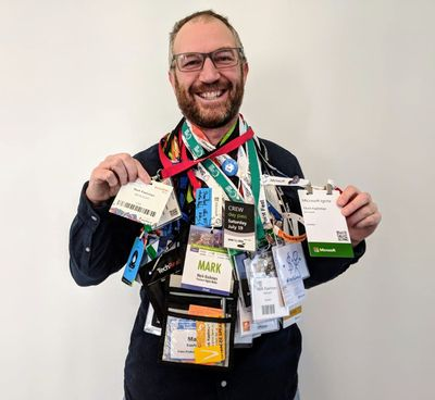 Mark Kashman showing all his conference badges from over the years. Send us your creative display of your conference badges or SWAG to enter the SPC19 full conference pass giveaway.