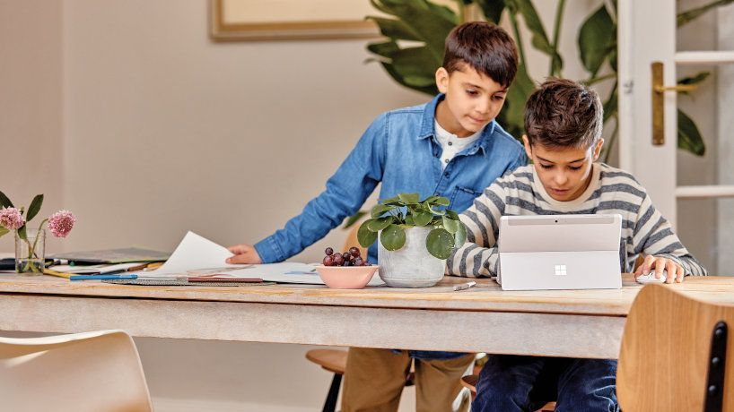 Students learning remotely at home with video
