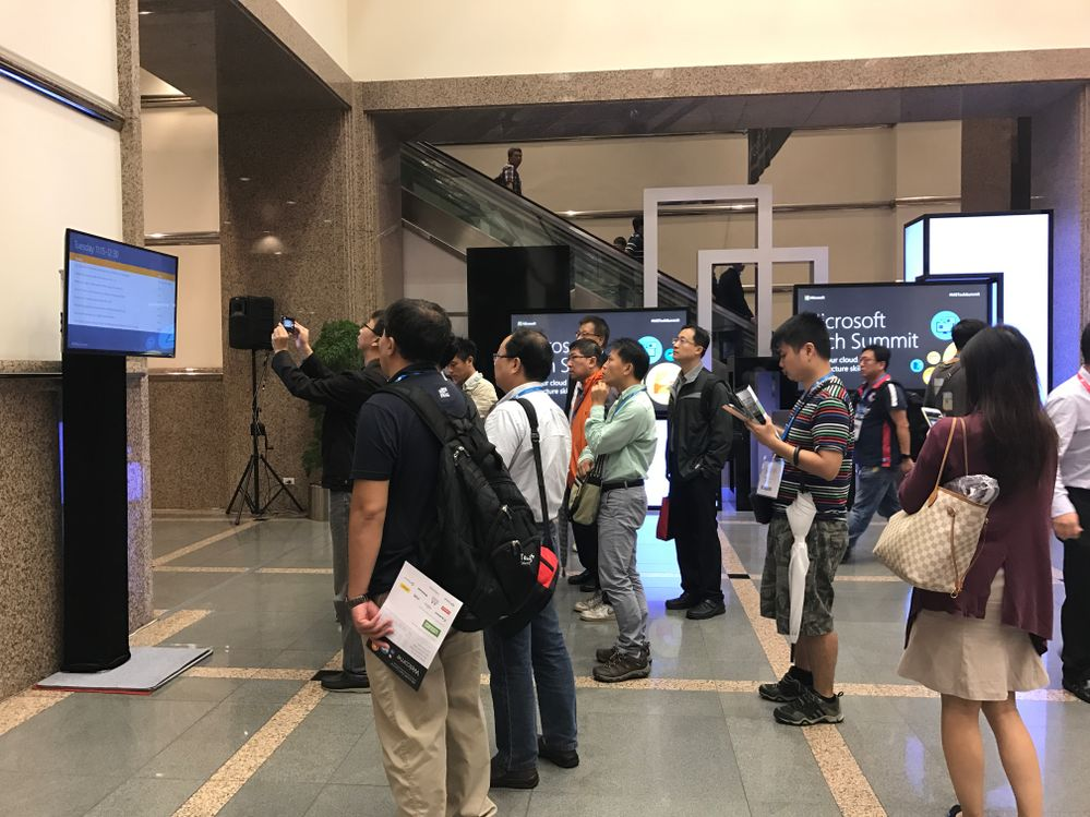 Microsoft Tech Summit attendees identifying sessions to attend.