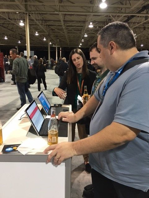New community members enjoying a beer and a demo during Ask the Experts. We added over 300 new members to our growing community during the event!